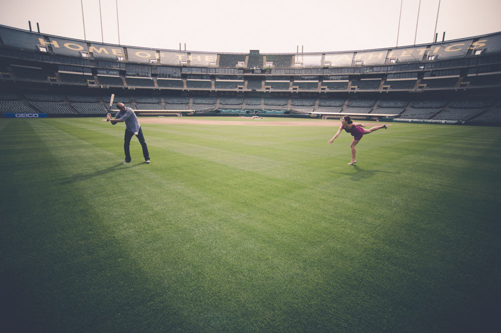 Engagement Portrait On The Field At Oakland A's Stadium