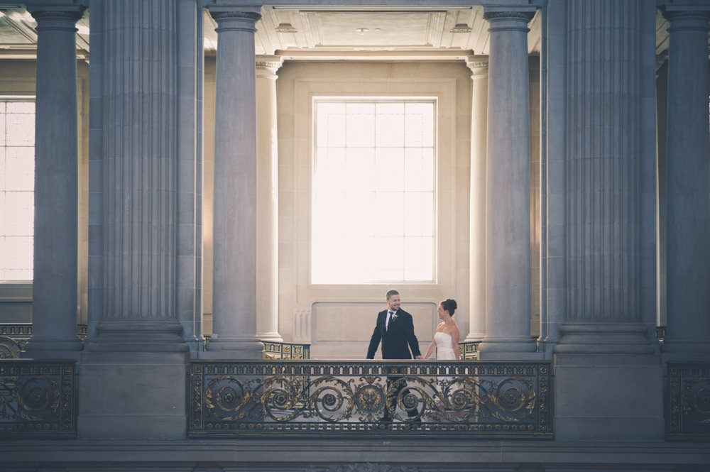 Couple Walking On Top Floor of San Francisco City Hall