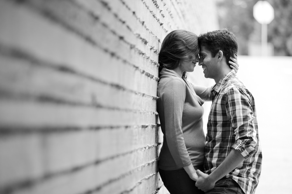 Black and White Portrait of Couple Smiling and Kissing