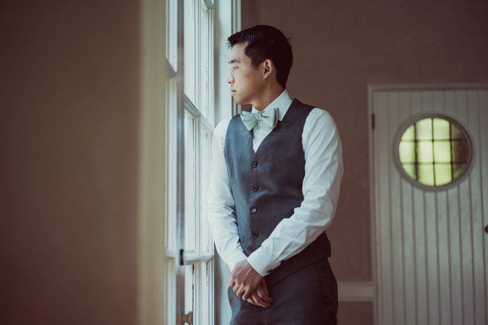 Groom waiting for first look at Piedmont Community Hall wedding