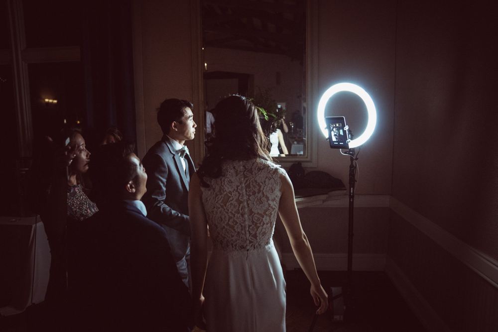 Guests in front of giffy.us ring light Piedmont Community Hall wedding