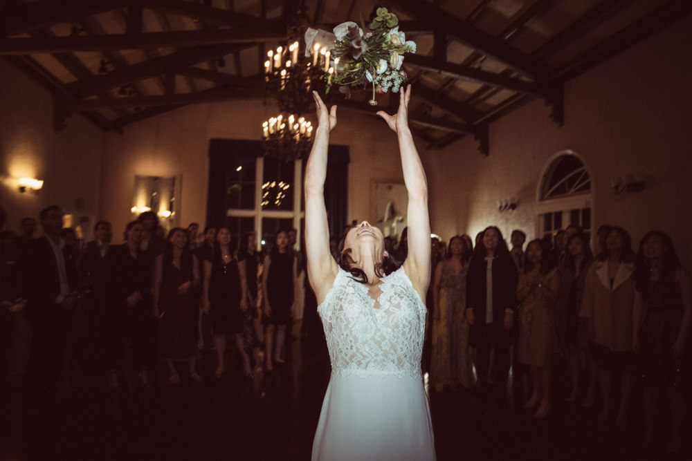 Bride bouquet toss at Piedmont Community Hall wedding