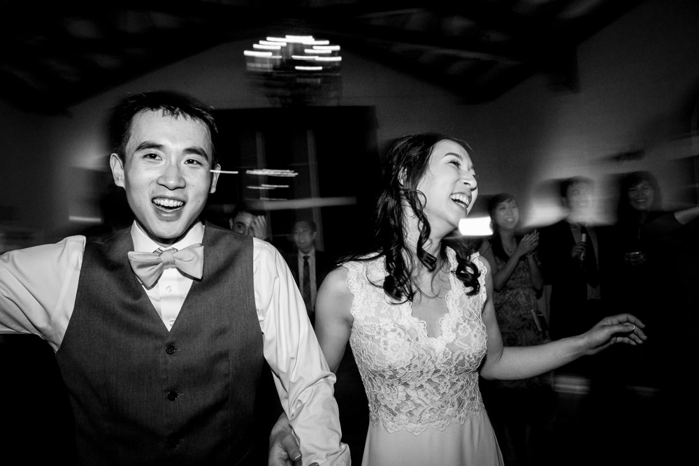 Black and white wedding dancing portrait at Piedmont Community Hall wedding