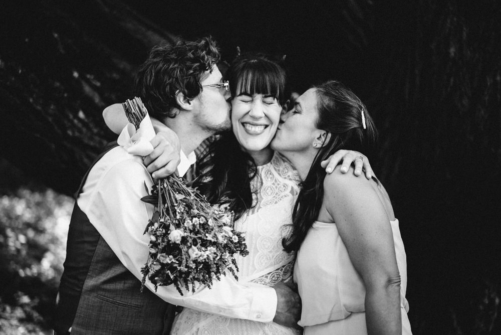 Black and white funny napa summer outdoors winemaker wedding kiss