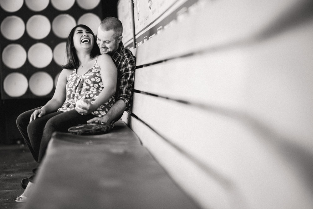Black and white engagement shoot ideas at baseball stadium