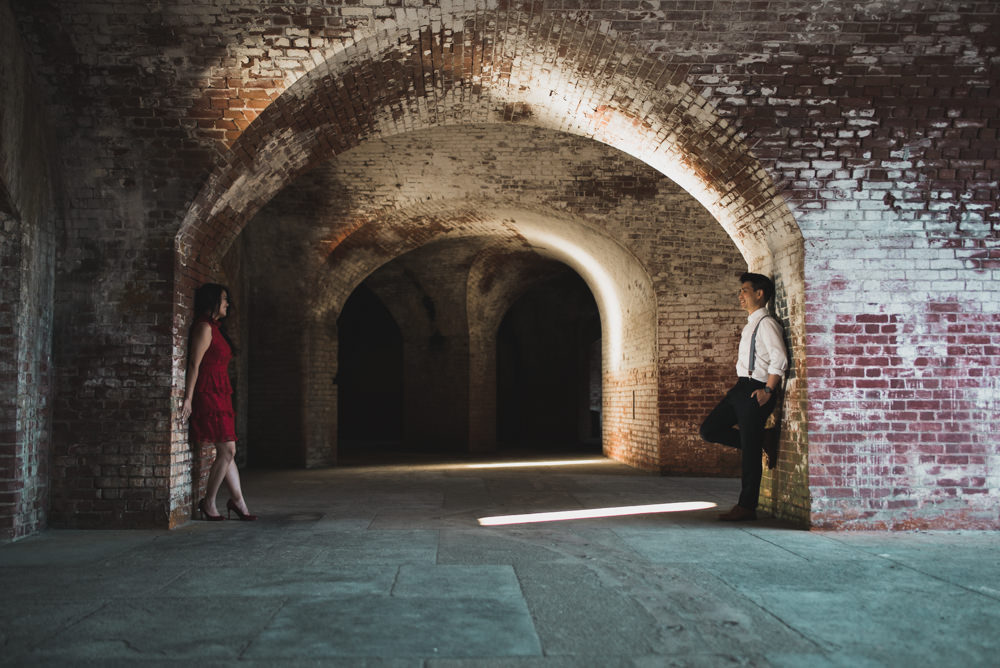 couple standing in tunnel at fort point