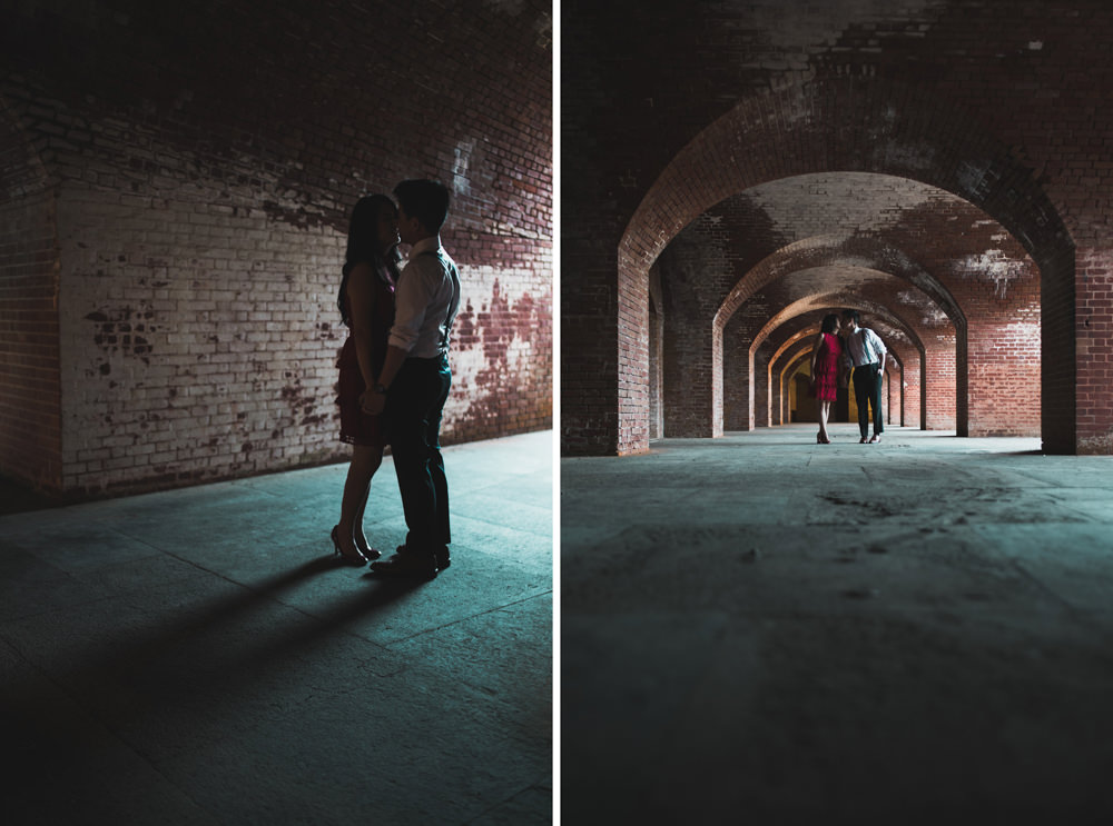 Couple in tunnel at fort point during engagement shoot