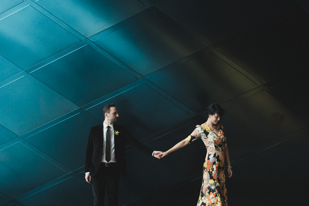 Beautiful shot of bride in floral dress outside Jewish Contemporary Museum