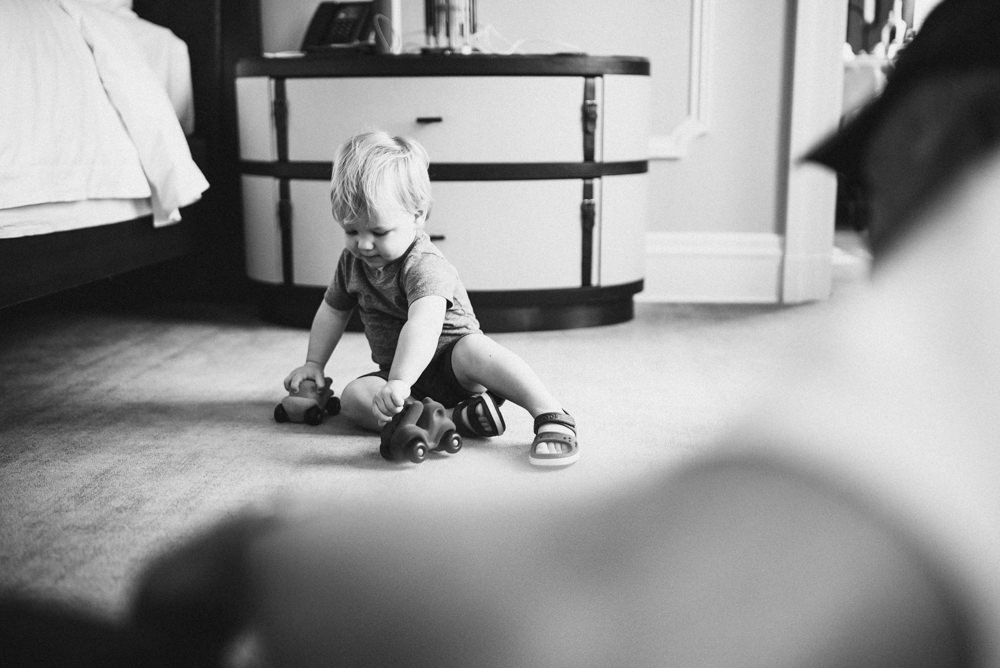Black and white candid shot of child playing with toy