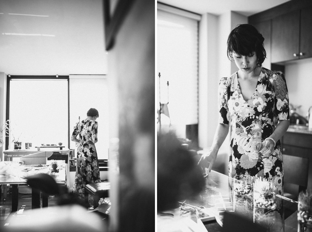 Black and white candid shot of bride in alternative floral wedding dress