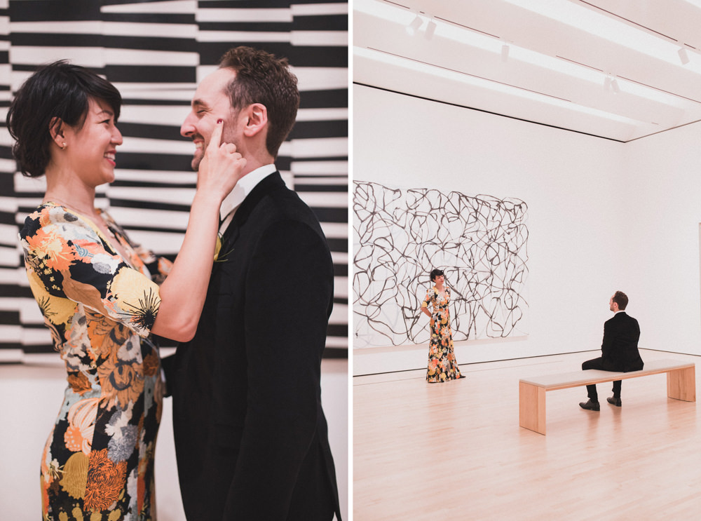 Couple posing in front of art work for wedding shoot in SF Moma