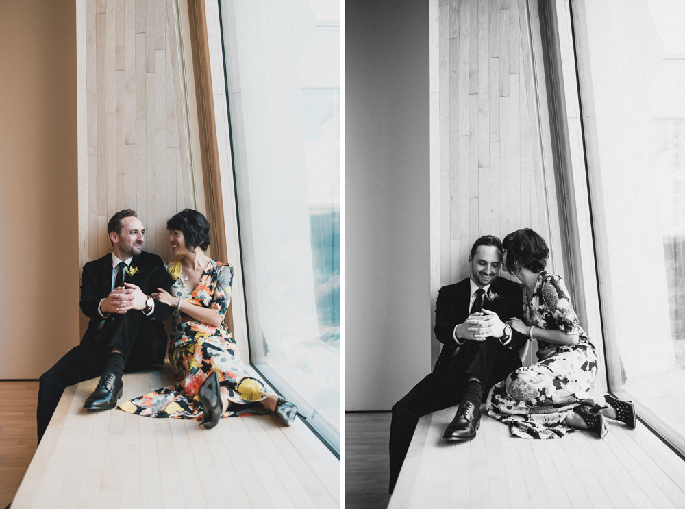 Couple sitting by window during wedding photography in SF MOMA museu