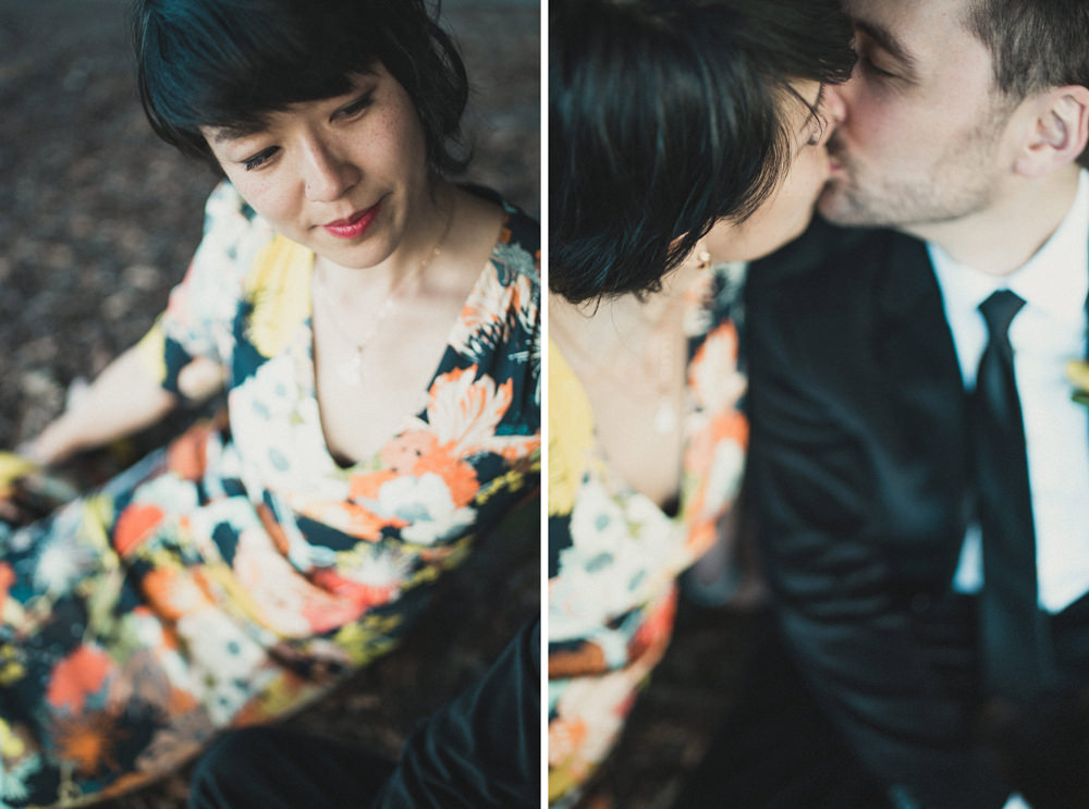 Couple kissing on ground during wedding portrait at Yerba Buena Center