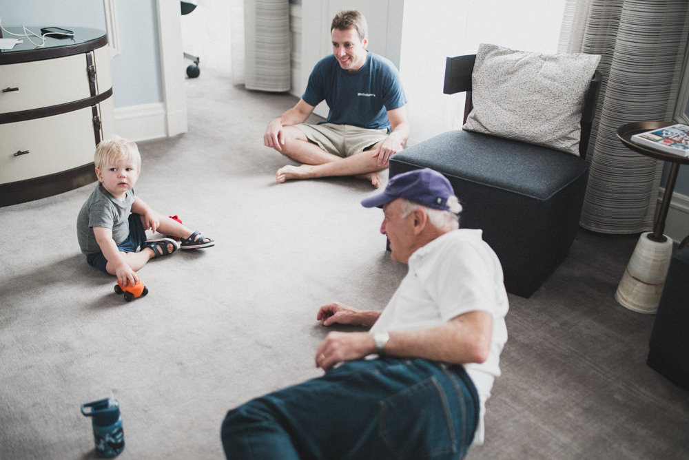 Candid shot of grandfather playing with grandson in the Palace Hotel
