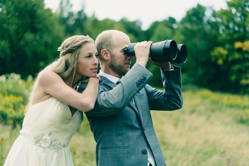 Outdoor safari themed wedding shoot with binoculars