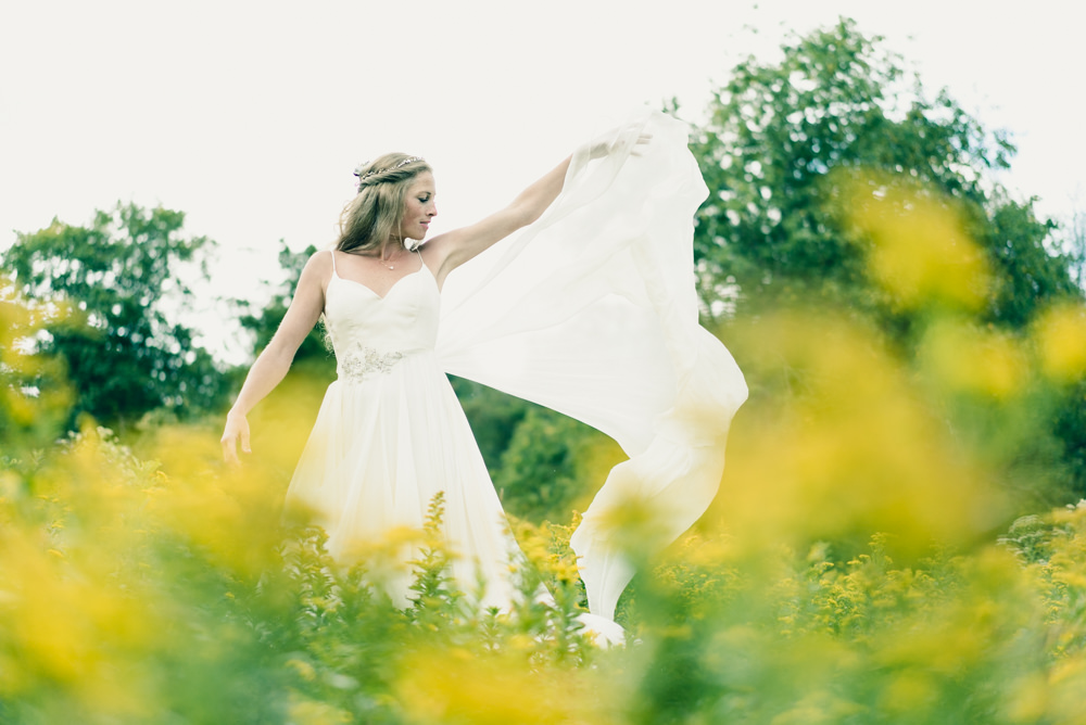 Fall themed chiffron wedding dress ideas in field of wildflowers