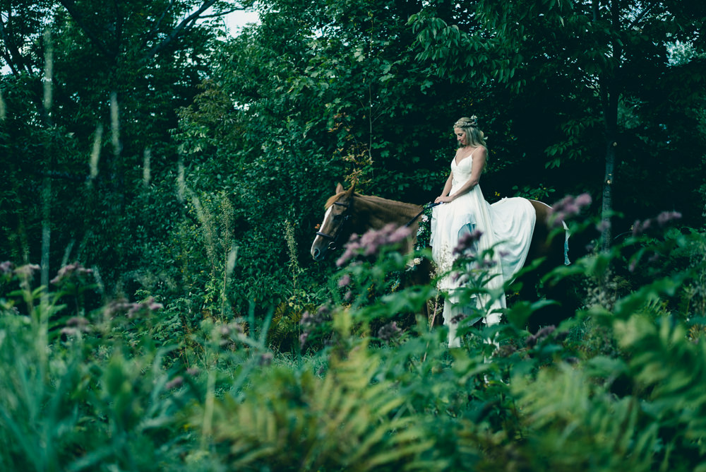 Best wedding portrait idea of bride on horse in woods